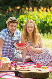 Young couple on a picnic holding watermelon Royalty Free Stock Photos
