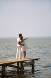 Young couple on a pier Royalty Free Stock Images