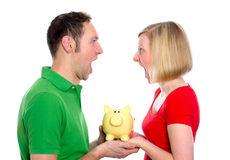 Young couple with piggy bank Royalty Free Stock Images