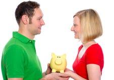 Young couple with piggy bank Stock Photos