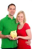 Young couple with piggy bank Stock Image