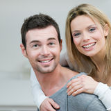 Young couple piggyback stock photography