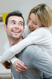 Young couple piggyback Royalty Free Stock Image