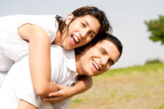 Young Couple Piggybacking Stock Image