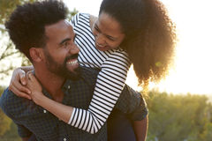 Free Young Couple Piggybacking Outdoors, Head And Shoulders Royalty Free Stock Image - 85337966