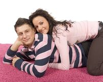 Young couple on the pink carpet Royalty Free Stock Image