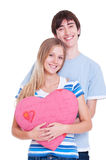 Young couple with pink heart Royalty Free Stock Photo