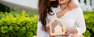 Young couple planning to buy a house concept. Young couple planning to buy a house and have happy living stock photography
