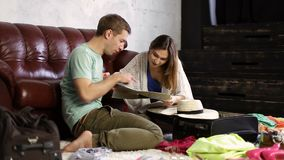 Young couple planning vacation trip with map stock footage