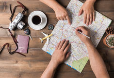 Young couple planning vacation trip with map. Top view. Pointing to Thailand map stock photo