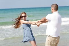 Young couple play. Happy young couple play at beach stock images