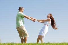 Young couple play at park Stock Photos