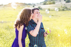 Young couple play together with bubble blower Royalty Free Stock Photography