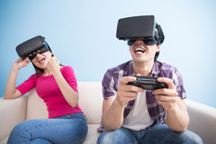 Young couple play vr game Stock Photos