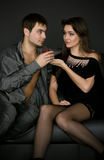 Young couple playing with apple Stock Images