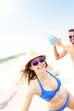Young couple playing with a ball at the beach Stock Image
