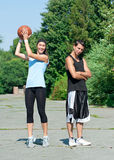 Young couple playing basketball Stock Image