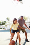 Young Couple Playing Basketball Together Stock Photo