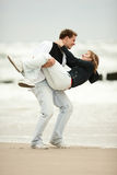 Young couple playing on beach Royalty Free Stock Image