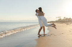 Young couple playing at the beach Royalty Free Stock Images
