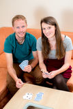 Young couple playing card game Stock Image