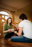 Young couple playing cards Stock Photos