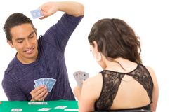 Young couple playing cards cuarenta Stock Photo