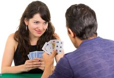 Young couple playing cards cuarenta Royalty Free Stock Photo