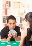 Young couple playing cards cuarenta Stock Photos