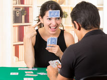 Young couple playing cards cuarenta Royalty Free Stock Photography