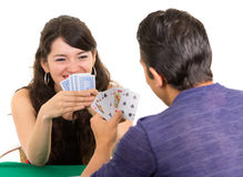 Young couple playing cards cuarenta Stock Image