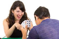 Young couple playing cards cuarenta Royalty Free Stock Image