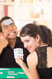 Young couple playing cards cuarenta Stock Images