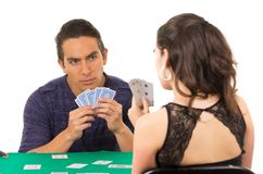 Young couple playing cards cuarenta Royalty Free Stock Photos