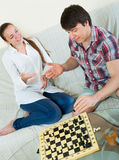 Young couple playing chess Stock Photography