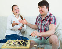 Young couple playing chess Royalty Free Stock Photo