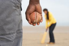 Young Couple Playing Cricket On Autumn Beach Holid Stock Photo