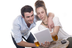 Young couple playing with a digital tablet Stock Photos