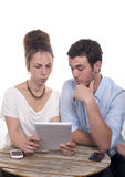 Young couple playing with a digital tablet Royalty Free Stock Photos
