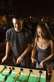 Young couple playing football table. Royalty Free Stock Photos