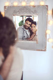 Young couple playing in front of a mirror Stock Photography