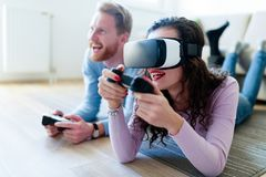 Young couple playing games with virtual reality headset. Young happy couple playing games with virtual reality headset together Stock Photography