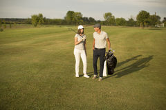 Young couple playing golf Stock Image