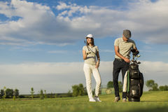 Young couple playing golf Royalty Free Stock Image