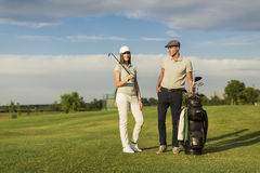Young couple playing golf Stock Photo