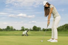 Young couple playing golf Royalty Free Stock Images