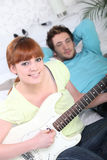 Young couple playing a guitar Royalty Free Stock Photography