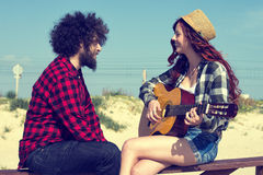 Young couple playing a guitar Royalty Free Stock Images