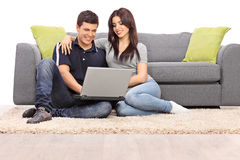 Young couple playing on a laptop Royalty Free Stock Photo