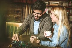 Move in game. Two best friends at cafe. Young couple playing leisure games together. Best friends at cafe Stock Photo